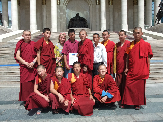 Canadian Long Rider Bonnie Folkins, Mongolian Long Riders Temujin and Moo Moo  present petition to Buddhist monks