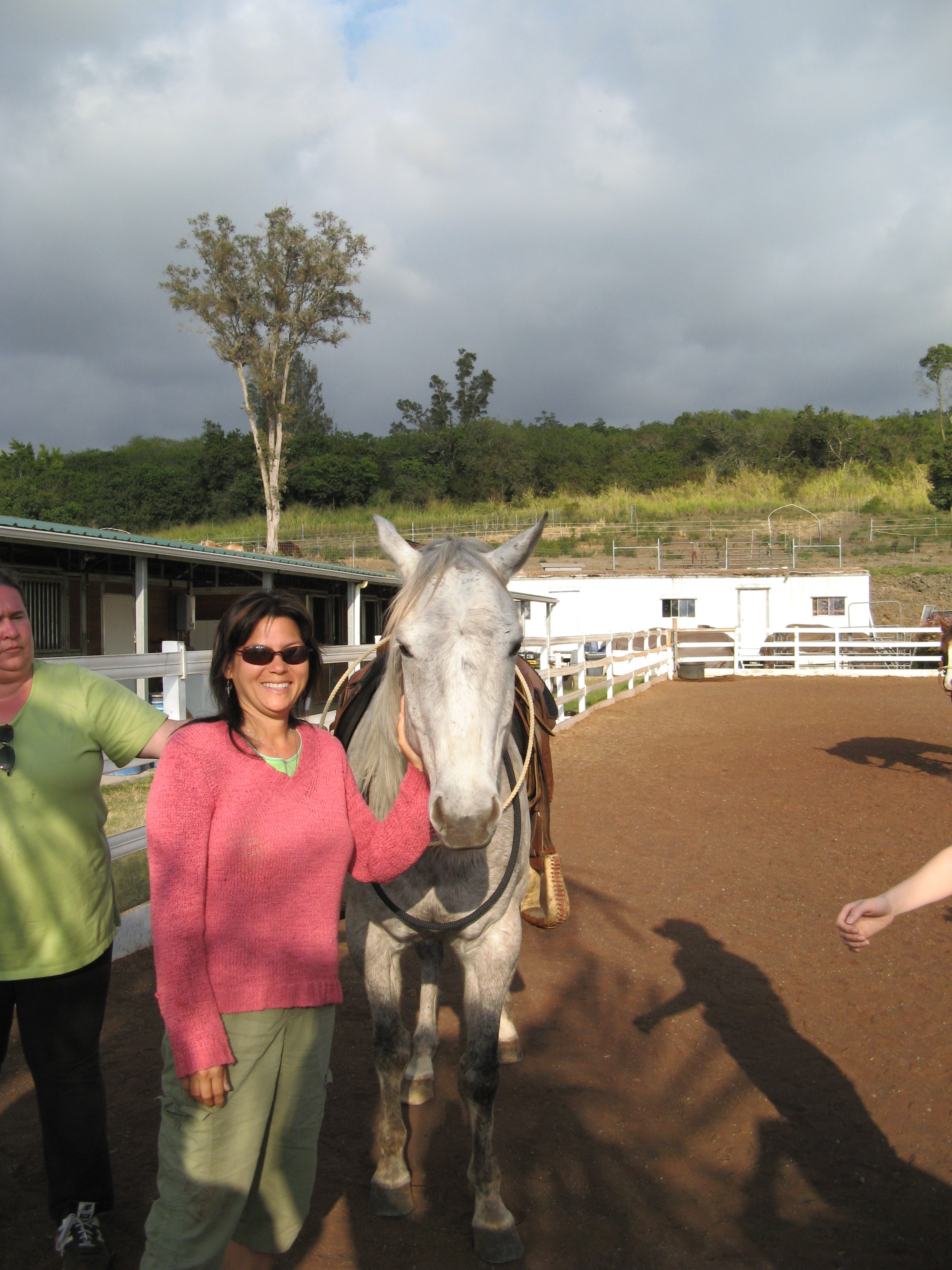 At Horse Play Stables in the lower arena. In the upper arena, you feel as if you are floating over the Pacific. Here you can see crops growing in the background going up the mountain.